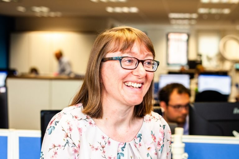 Private Client Senior Manager in open plan office